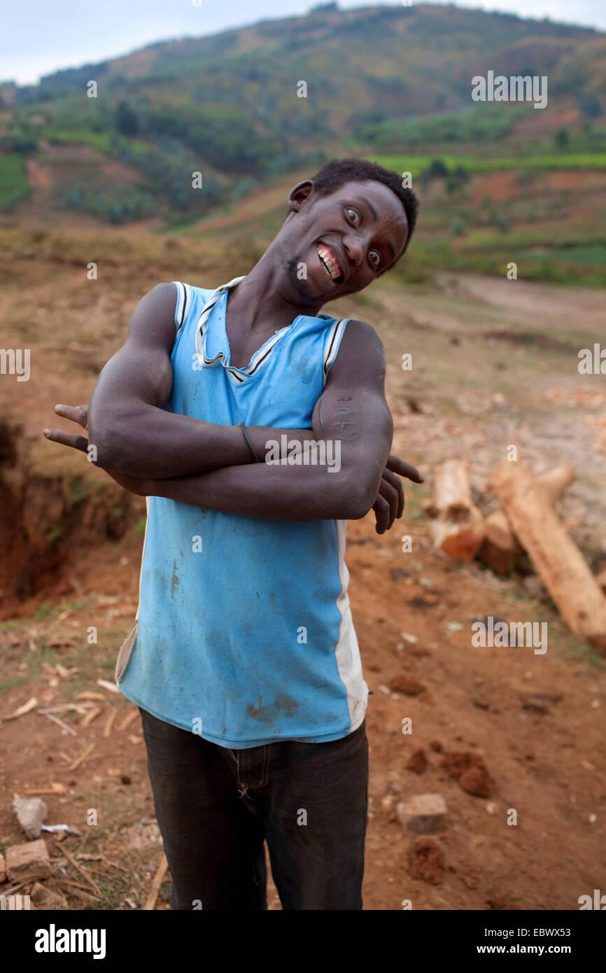 man with crossed arms making a face, Burundi, Karuzi, Karuzi - Stock Image