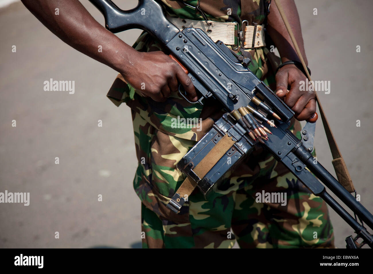 machine gun hanging over a soldier's shoulder during an event at the Independence Day (Juli 1), Burundi, Bujumbura - Stock Image
