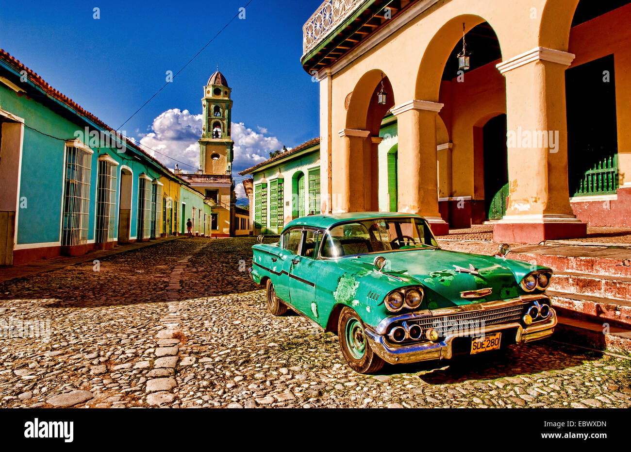 Old worn 1958 Classic Chevy on cobblestone street in center square of Trinidad, Cuba, Trinidad - Stock Image