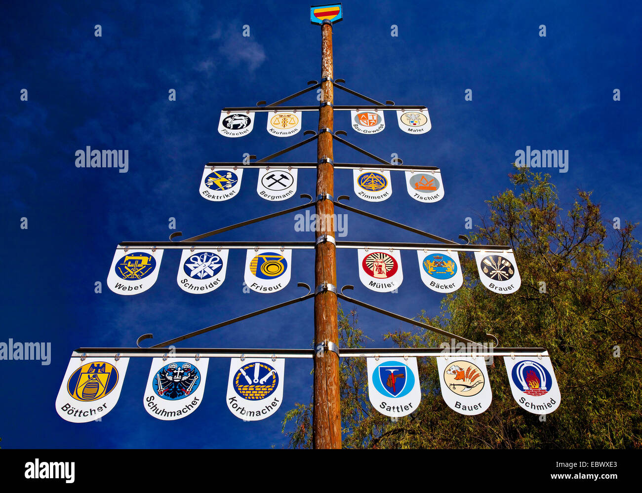 kind of maypole with emblems of different professions in Selm, Germany, North Rhine-Westphalia, Ruhr Area, Selm - Stock Image