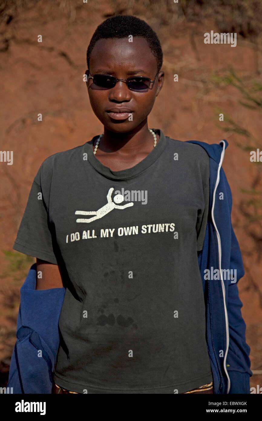 portrait of a young woman with t-shirt labeled 'I do all my own stunts', Burundi, Karuzi, Karuzi - Stock Image