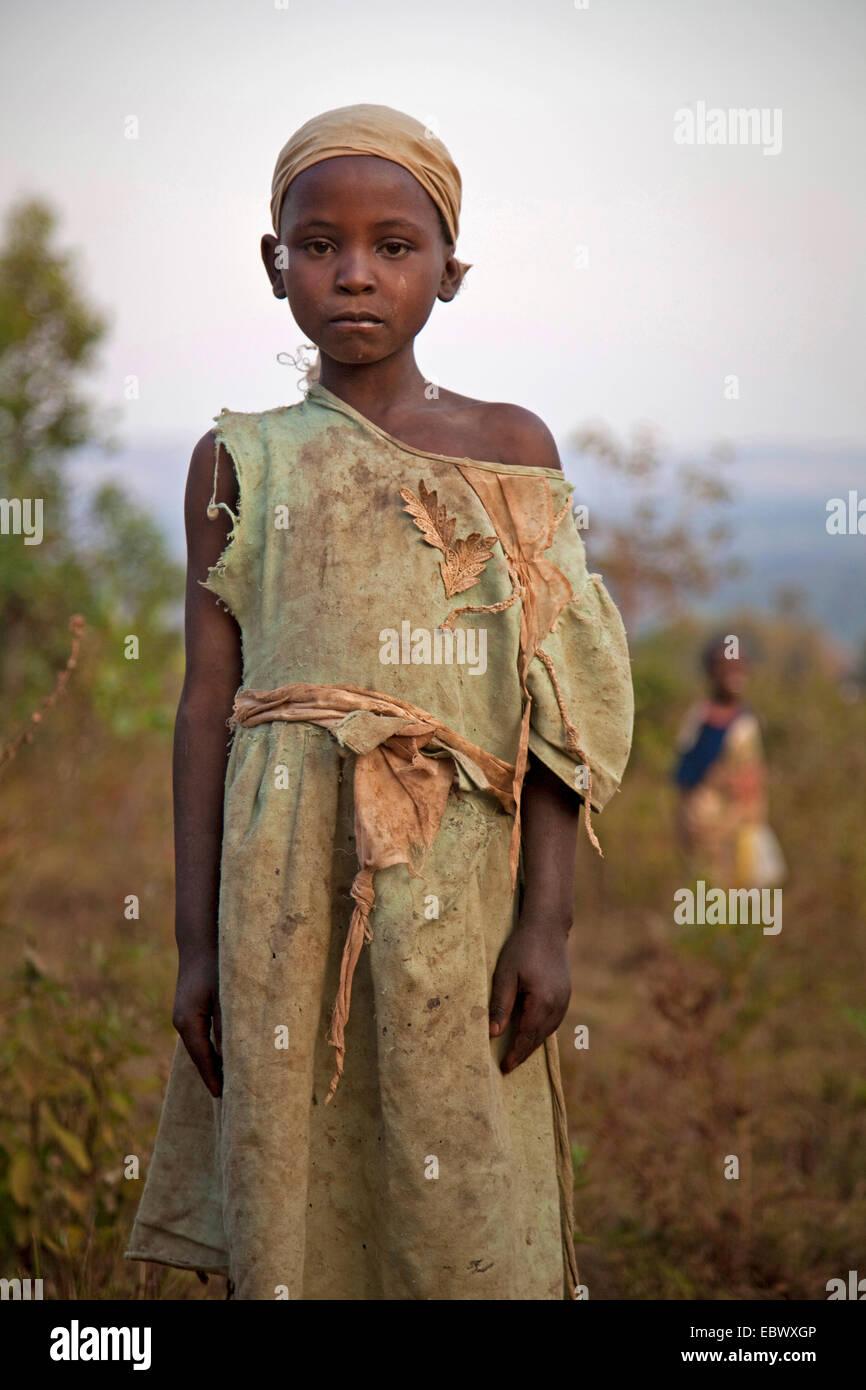 portrait of a young girl in worn-out dress, Burundi, Karuzi, Buhiga - Stock Image