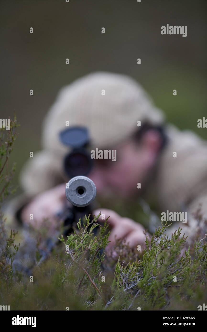 view into gun barrel of a deer stalker, United Kingdom, Scotland, Cairngorms National Park - Stock Image