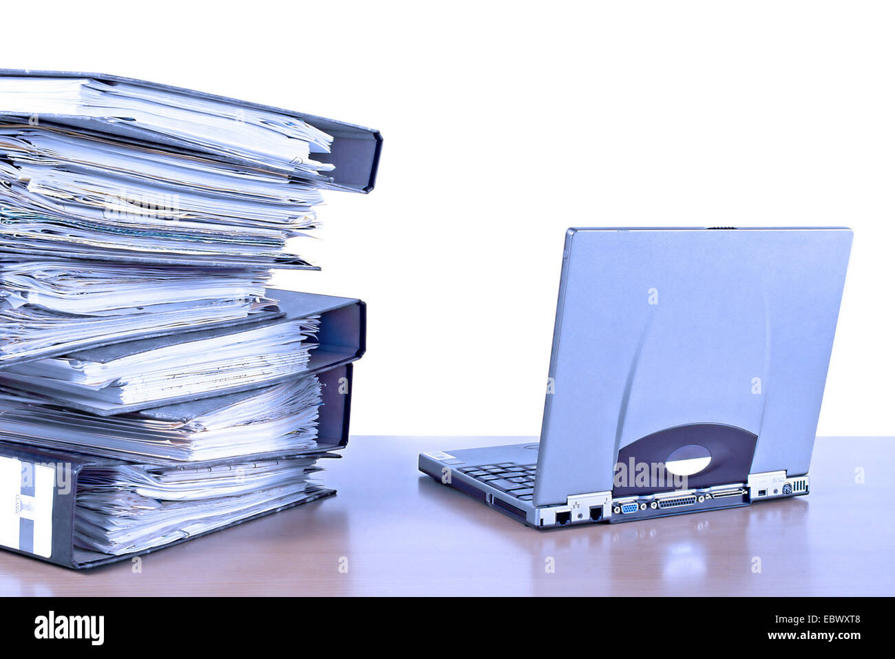 mountain of files and Notebook - Stock Image