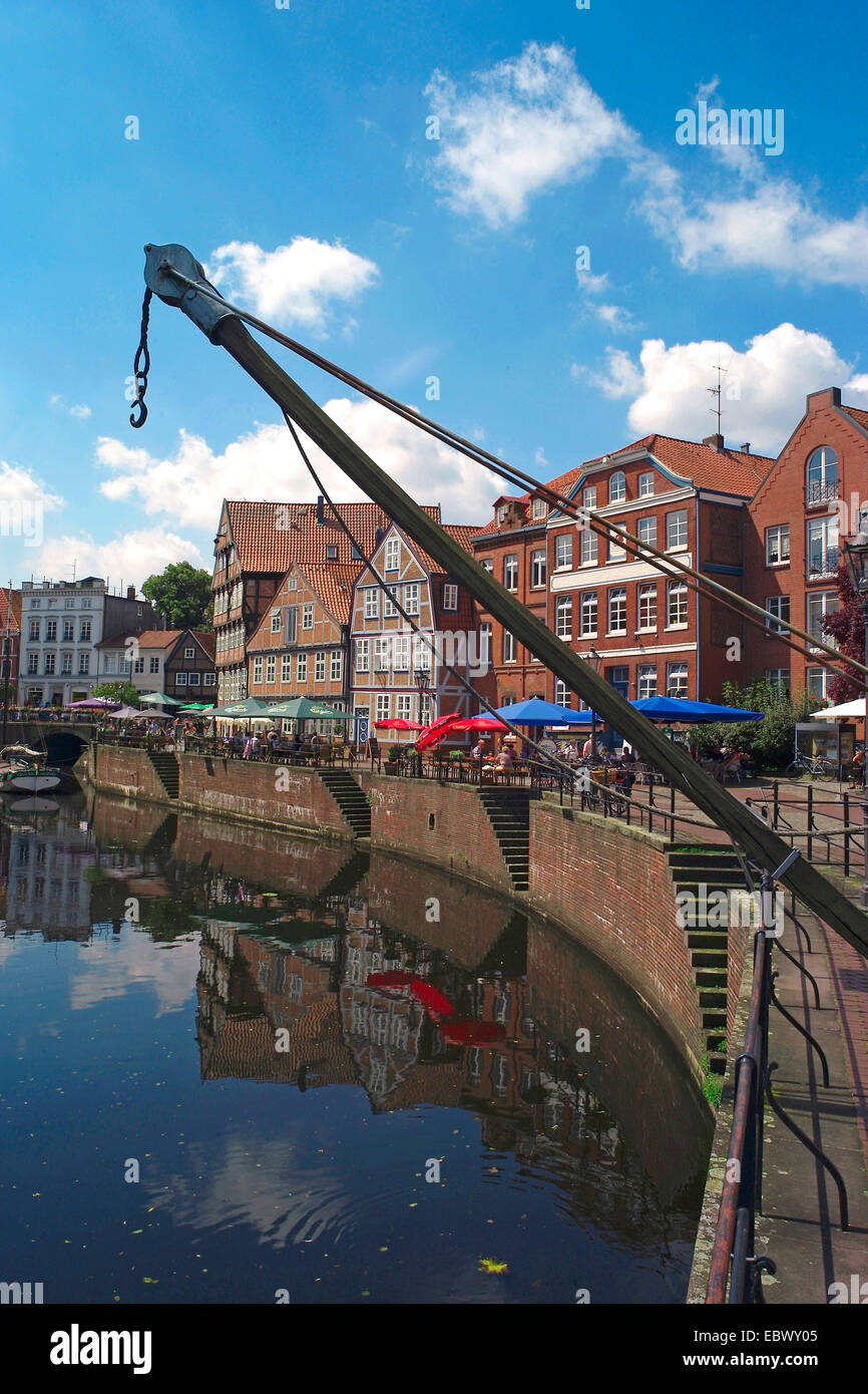 sight of the old hanse-harbor with loading crane at the quay, Germany, Lower Saxony, Stade - Stock Image