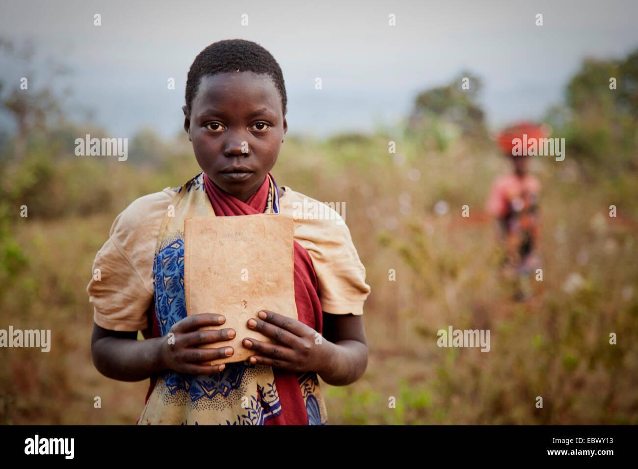 proud girl showing her exercise book , Burundi, Karuzi, Buhiga - Stock Image