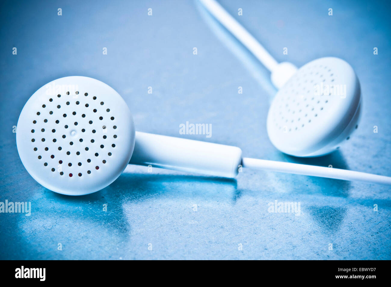 closeup of a pair of in ears headphones or earbuds - Stock Image