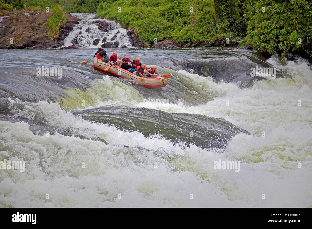 tourists with a local guide are rafting down the Bujagali waterfalls and are about to reach a wild rapid, Uganda, - Stock Image