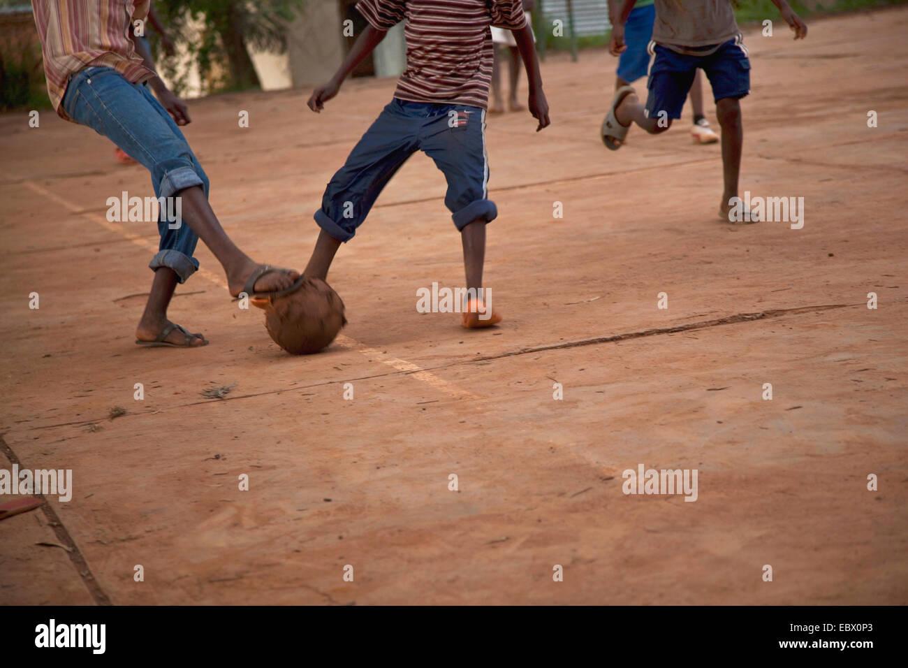 Adolescents playing soccer - football on a concrete area, Rwanda, Nyamirambo, Kigali - Stock Image