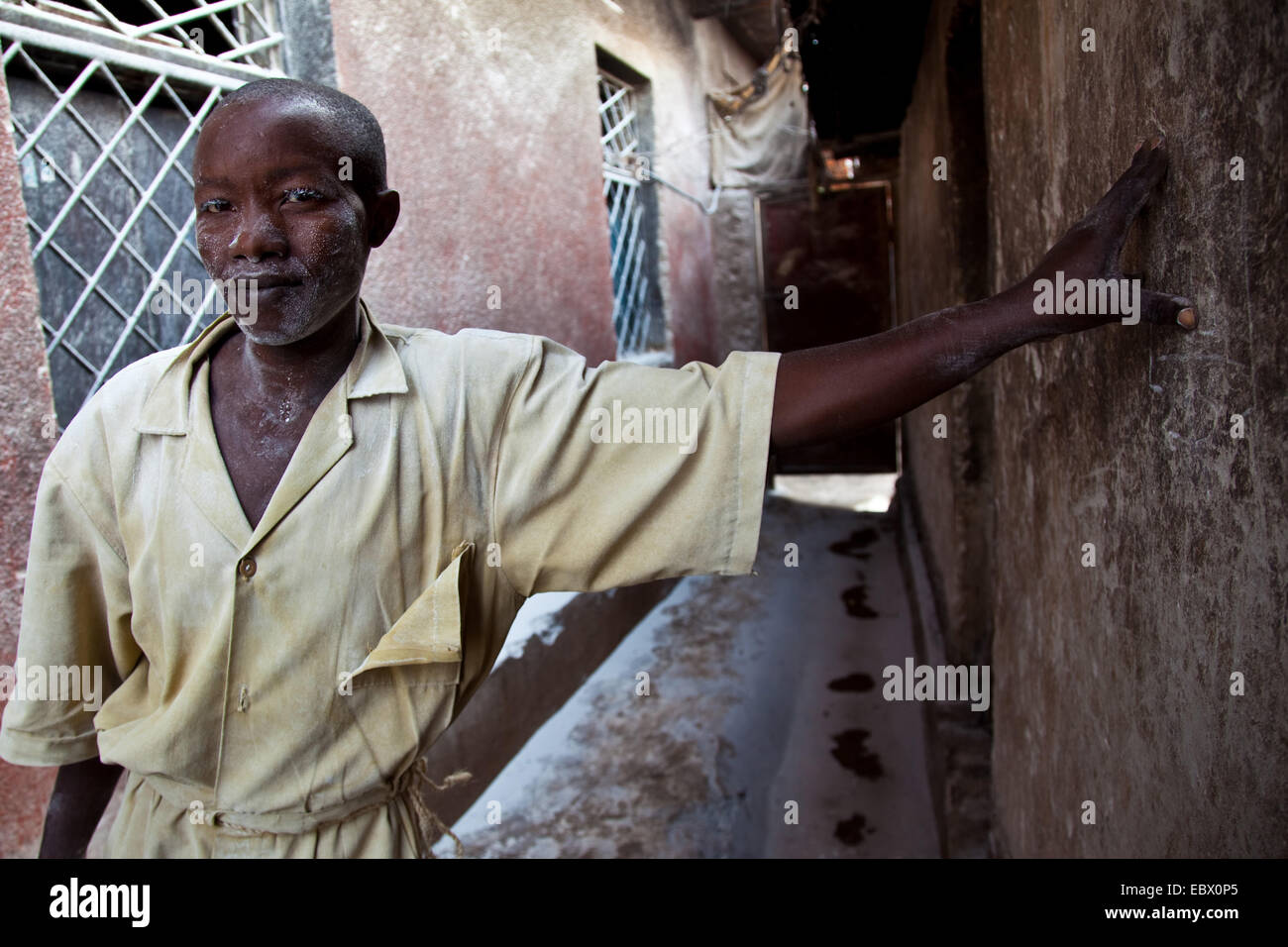 worker in a small local flour factory that produces flour from the cassava plant, Rwanda, Nyamirambo, Kigali - Stock Image