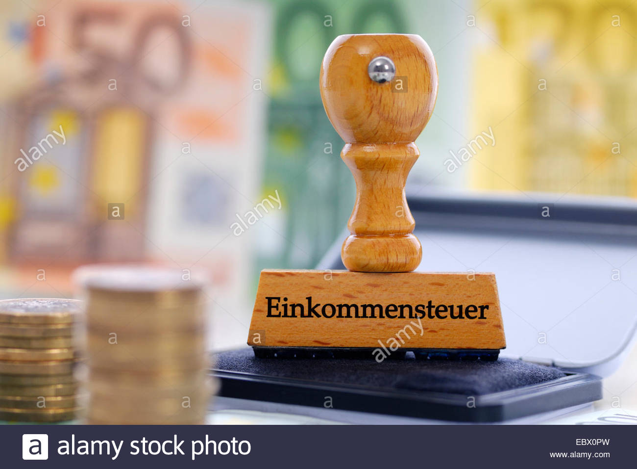 stamp with title Einkommenssteuer, income tax - Stock Image