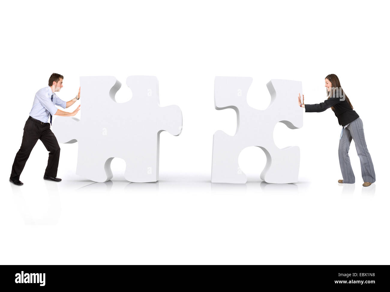 business partners putting puzzle together - Stock Image