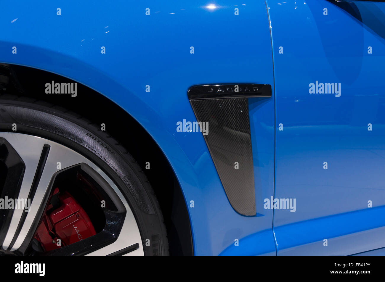 detail of Jaguar wheel with red brake assembly and bodypart with jaguar on it. J - Stock Image