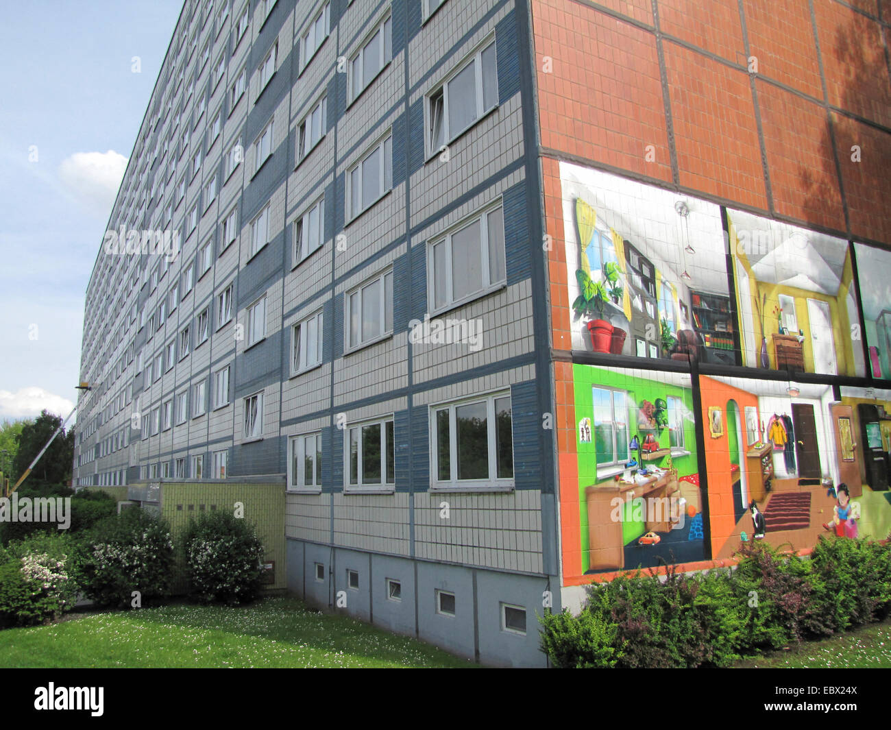 housing estate in former East Germany, socialist buildings, paintings on side wall of the building, Germany, Mecklenburg - Stock Image