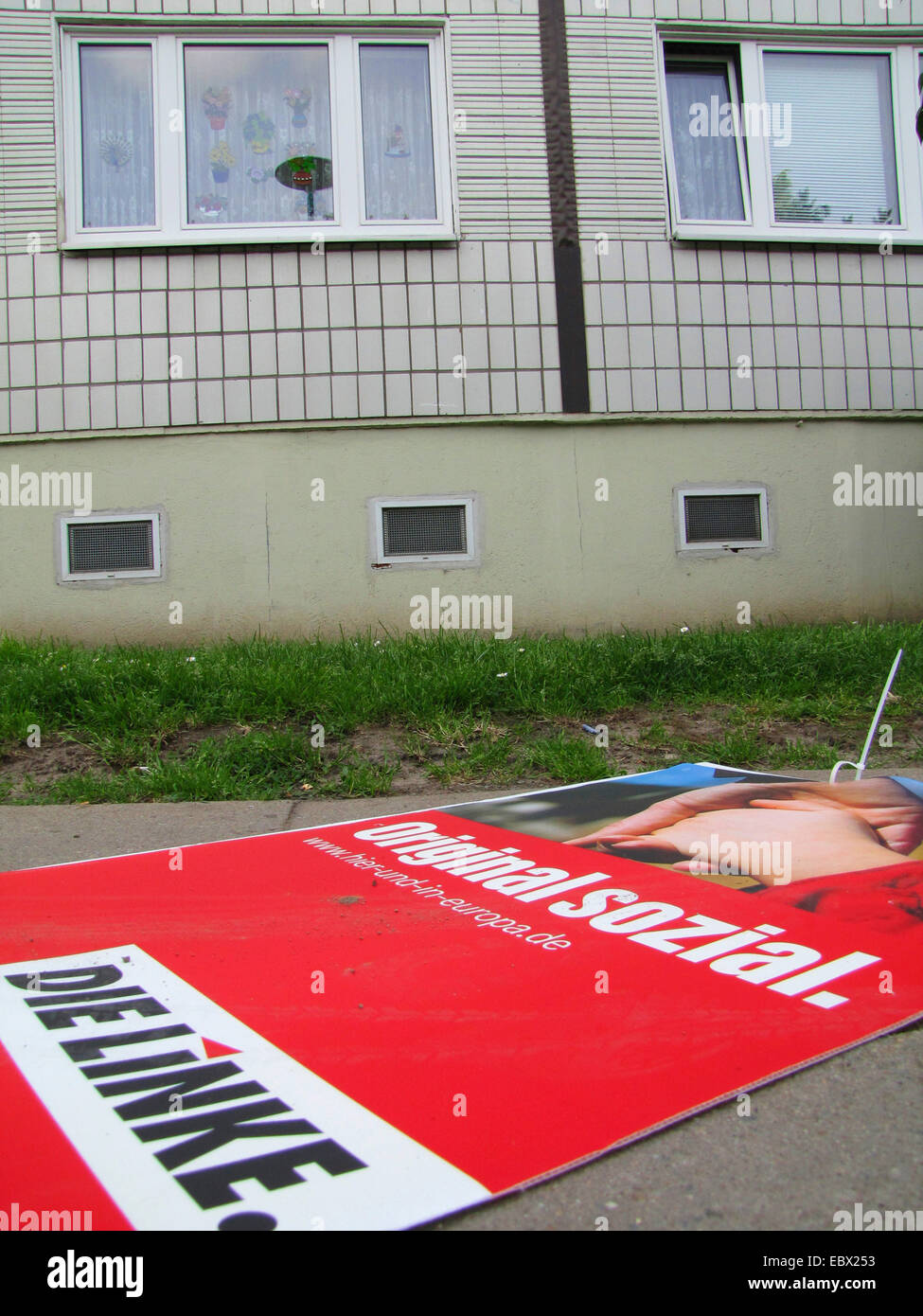 housing estate in former East Germany, socialist buildings, election poster of the left-wing party 'Die Linke' - Stock Image