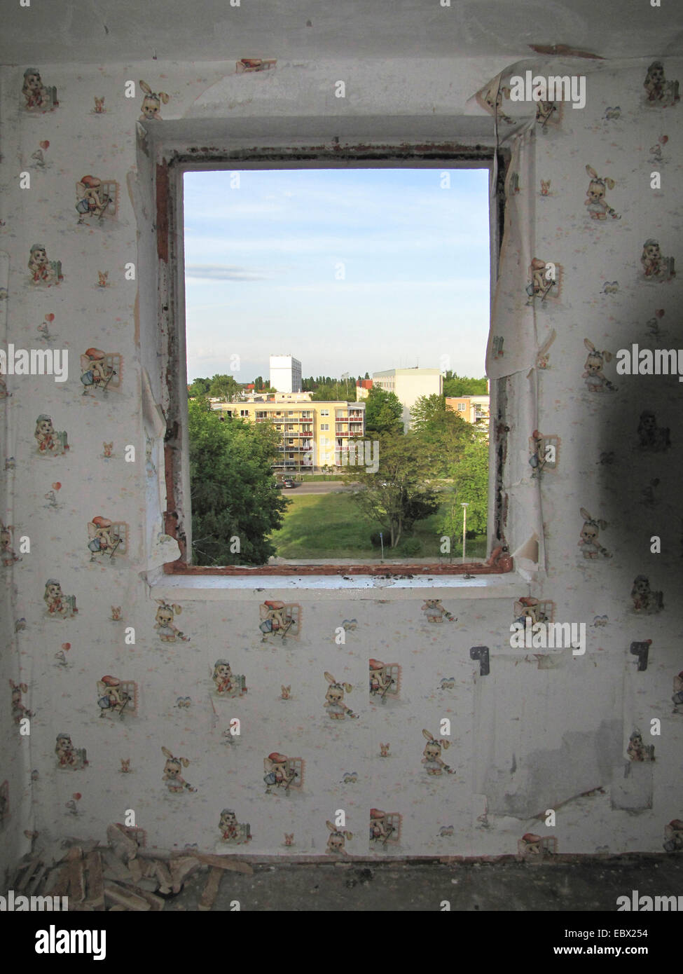 view out of the former nursery of an abandonned appartment in a run down housing estate, Germany, Mecklenburg-Western - Stock Image