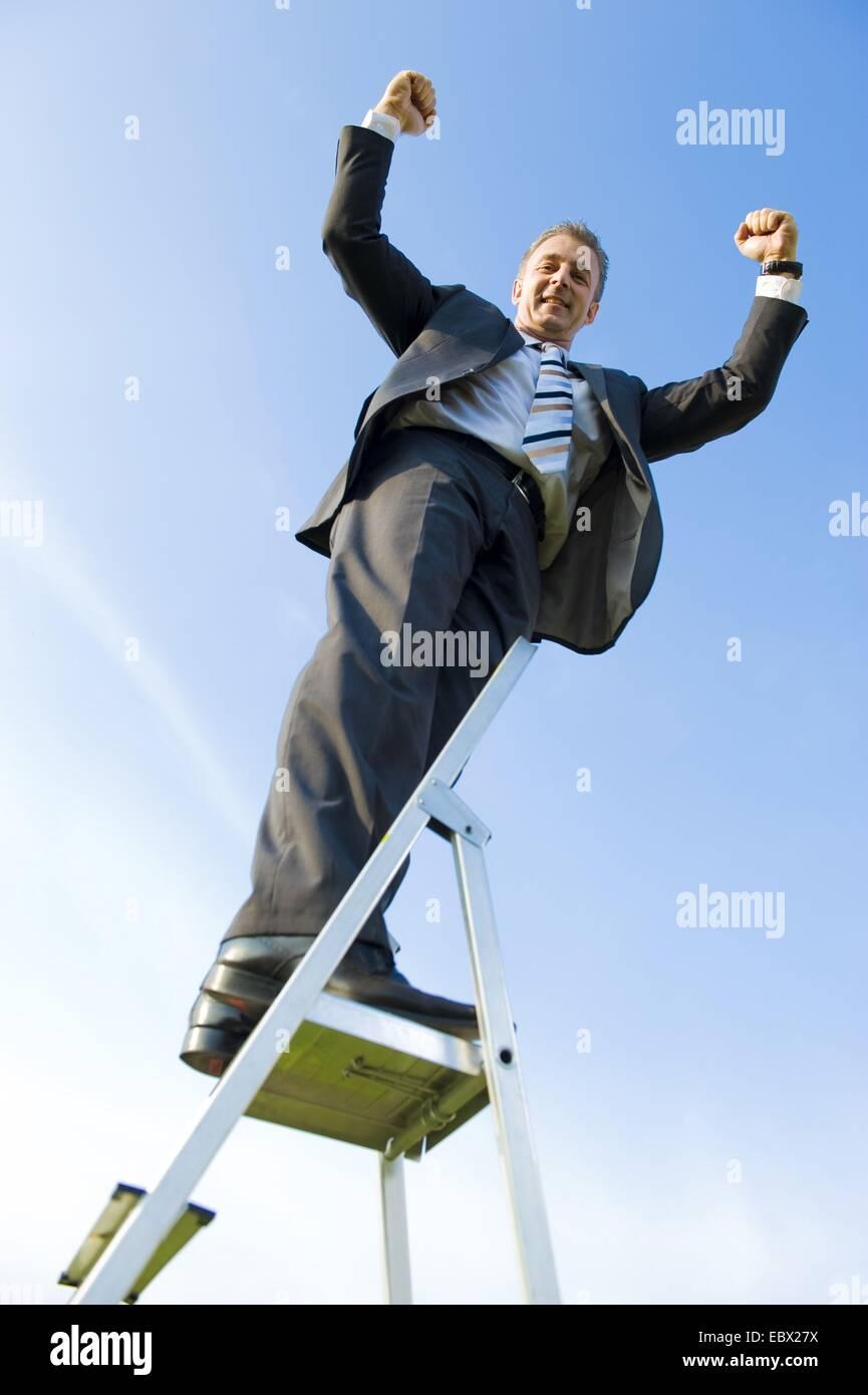 business carreer, business man on career ladder - Stock Image
