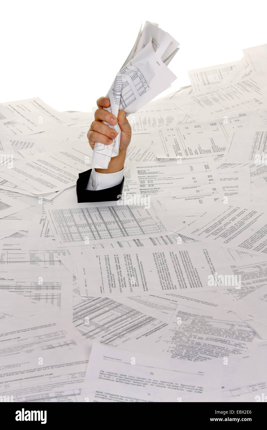 business man bogging in a heap of text documents with only one arm looking out - Stock Image