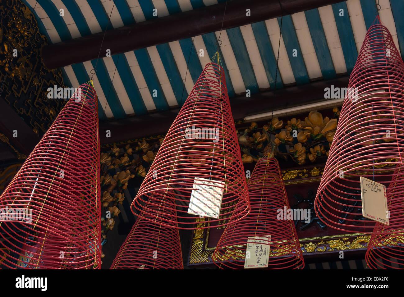 Incense coil burning at Hokien (Fujian) Meeting Hall, Phuc Kien in Hoi An Vietnam - Stock Image