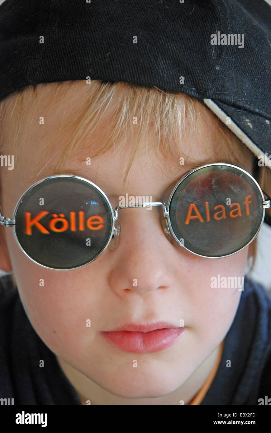six years old boy with carnival glasses, Germany, North Rhine-Westphalia Stock Photo