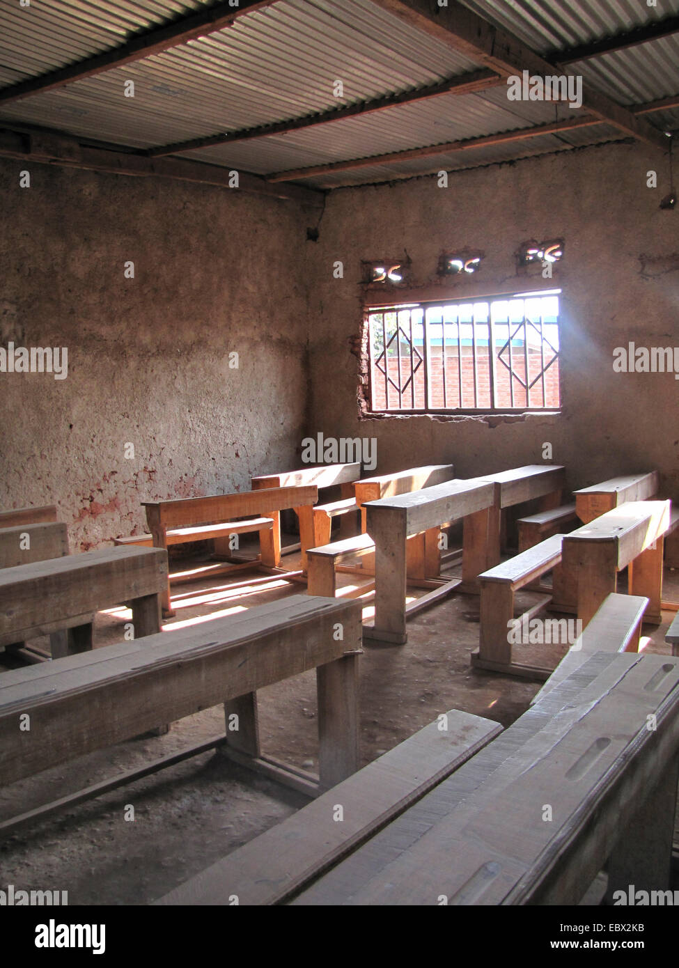 primitive class room with wooden benches, Burundi, Bujumbura mairie, Buyenzi, Bujumbura Stock Photo
