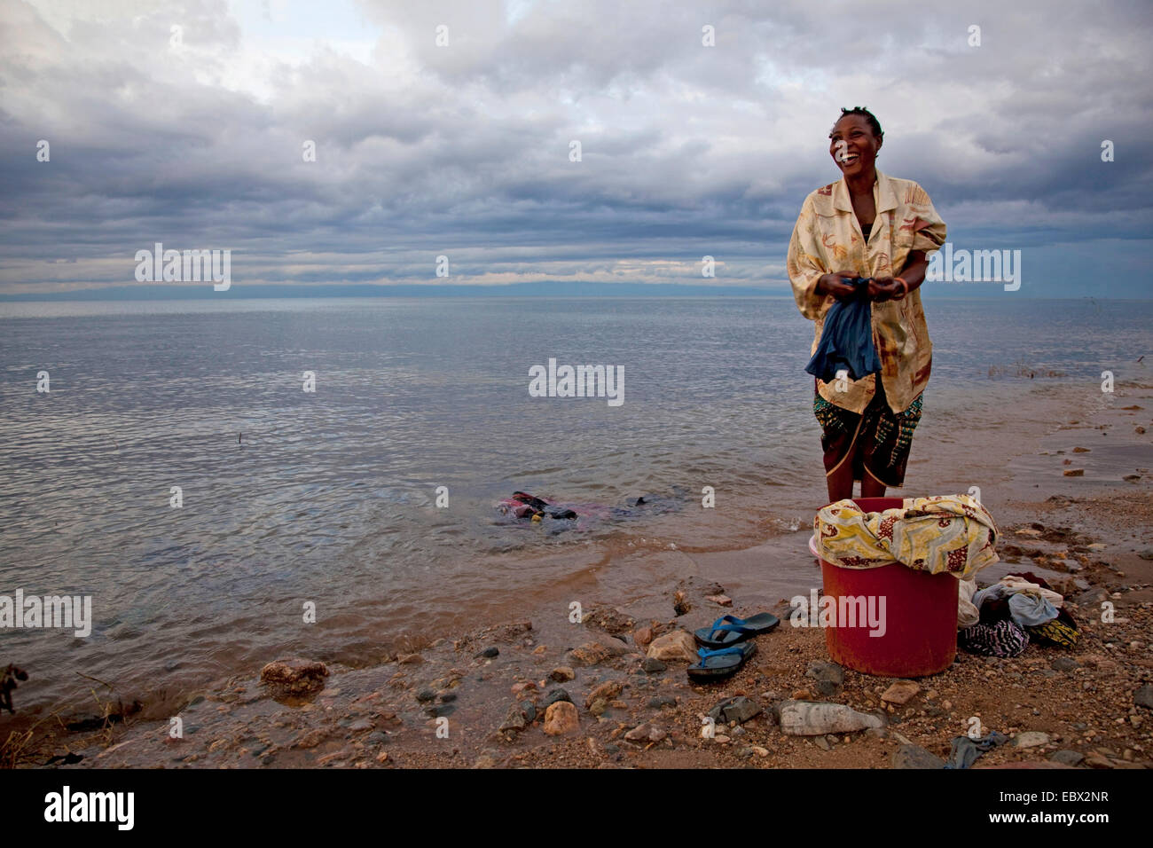 woman washing laundry at Lake Tanganyika, Burundi, Makamba - Stock Image
