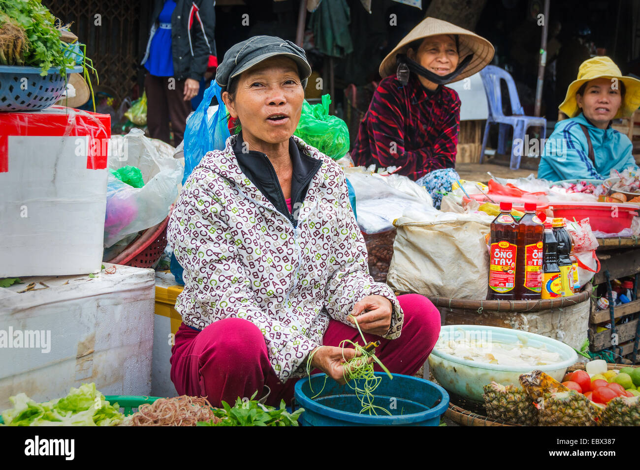 South East Asian woman market trader laughing at the camera. Market in Danang Vietnam - Stock Image