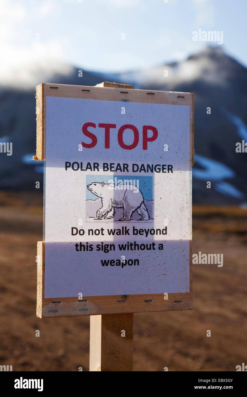 polar bear (Ursus maritimus), warning sign polar bear danger, demand for bearing weapons, Norway, Svalbard, Ny Alesund - Stock Image