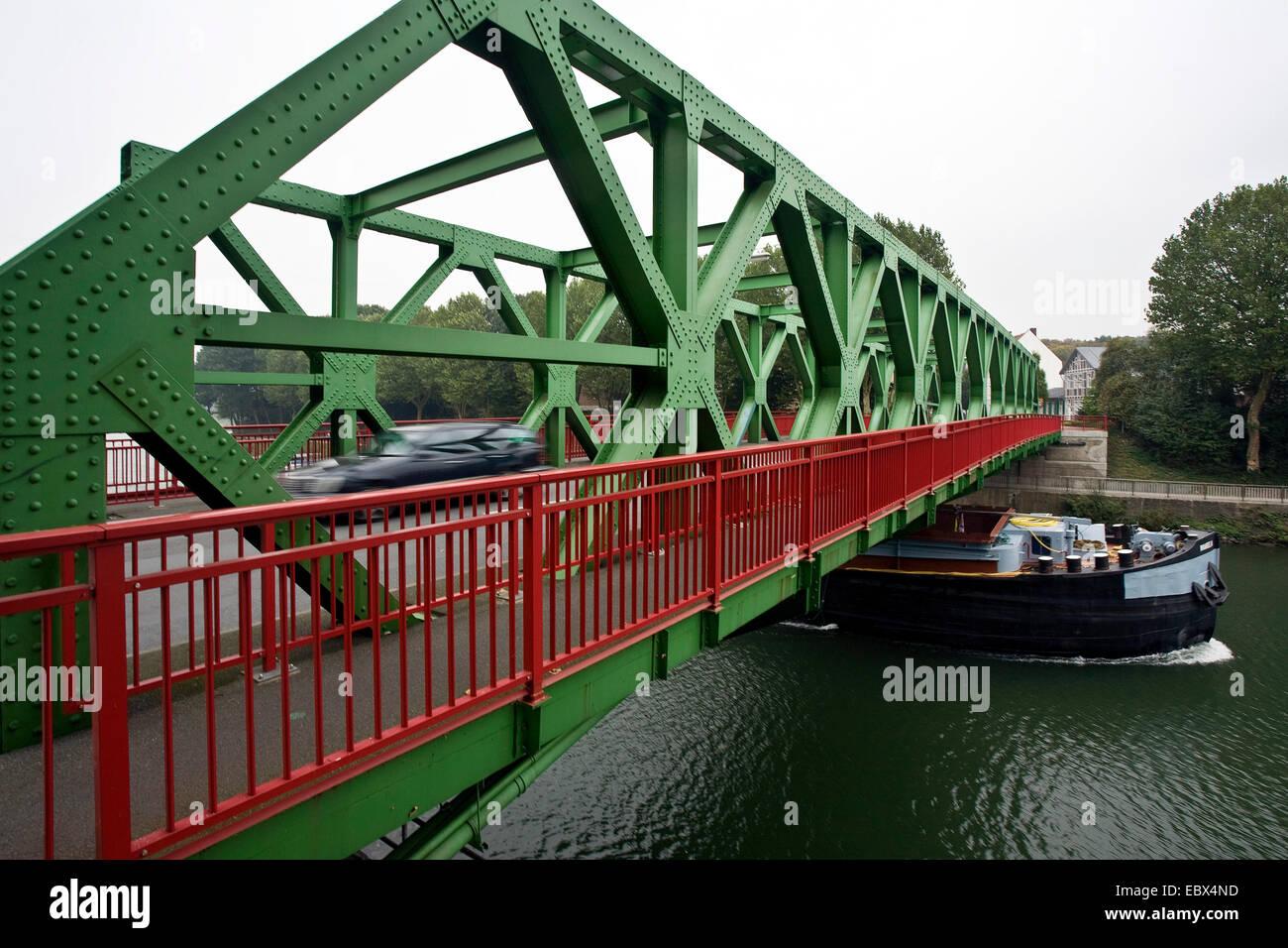 cargo ship on Dortmund Ems canal, a car passing the Lucas bridge, Germany, North Rhine-Westphalia, Ruhr Area, Datteln - Stock Image