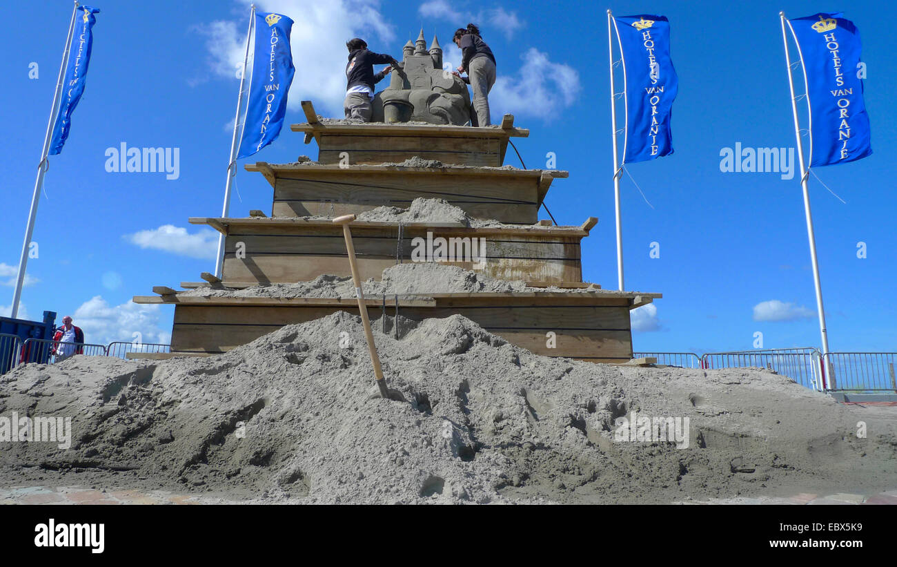 building of a sand figure at the sea front, Netherlands, Noordwijk - Stock Image