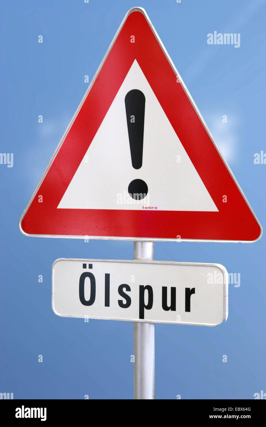 warning oil on road - Stock Image