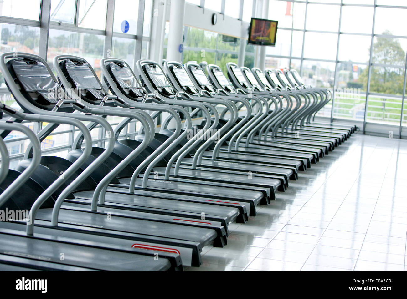 Series of treadmills in a row in the gym - Stock Image