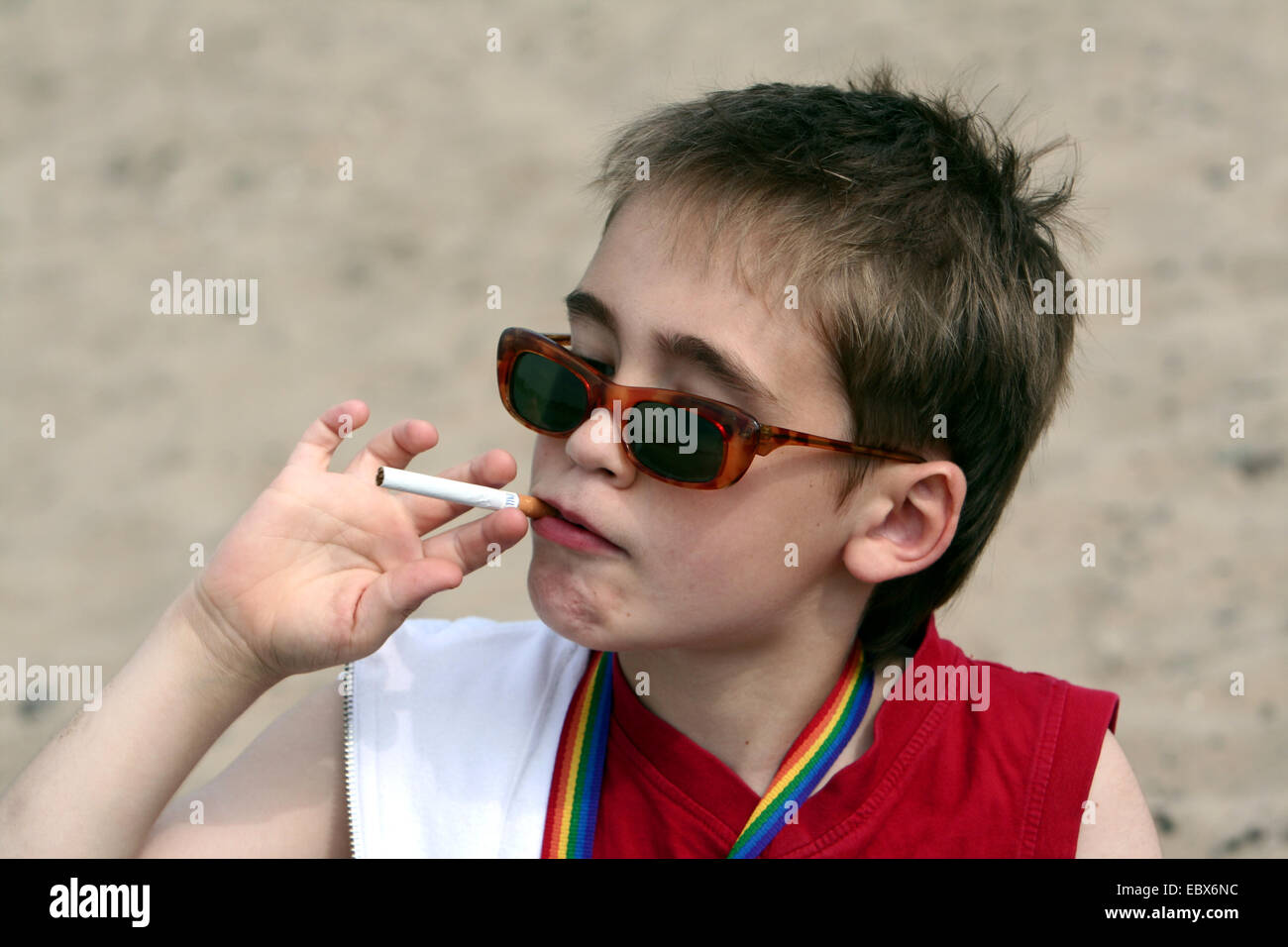 10 years old cool boy with sunglasses and cigarette stock image
