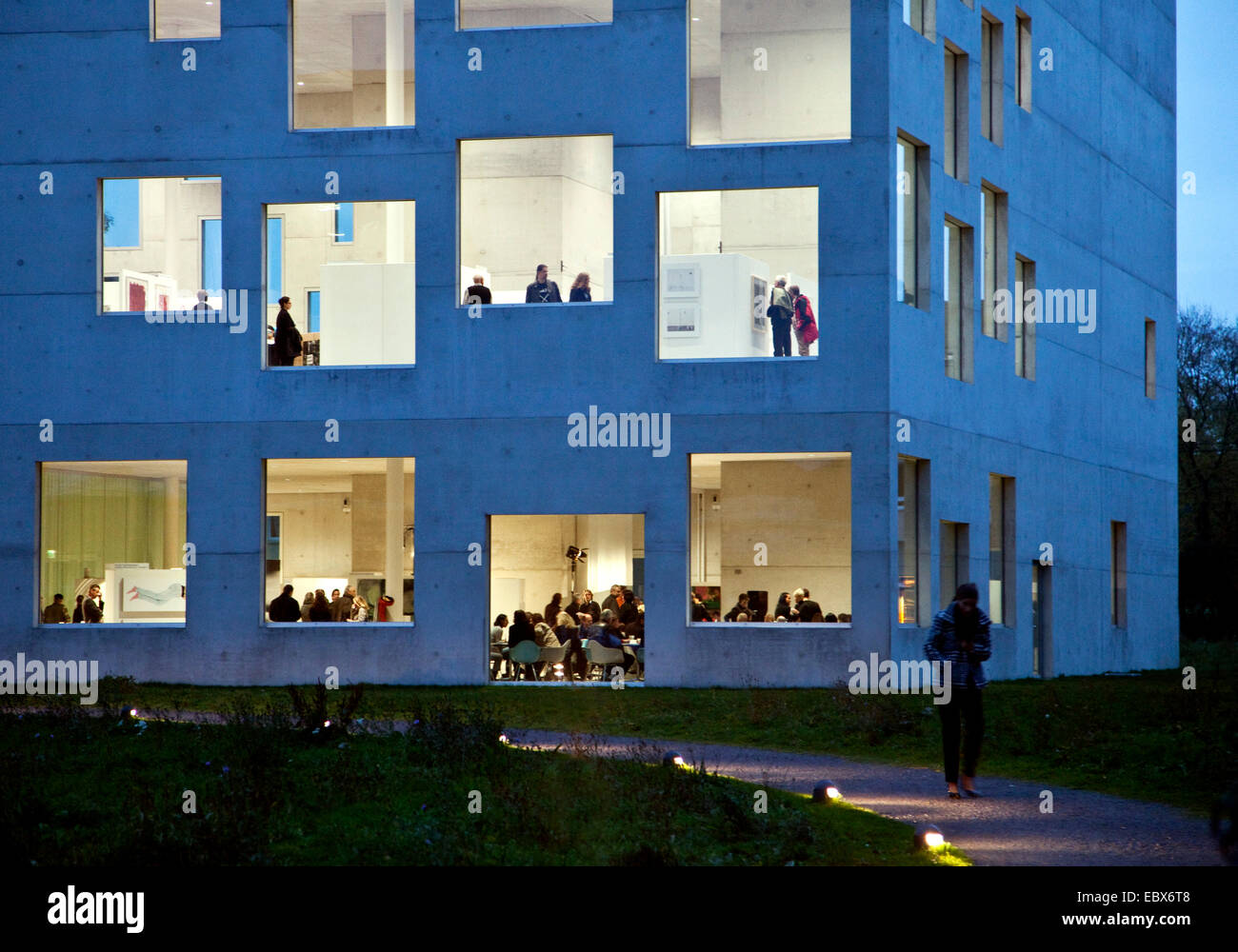 people in Zollverein School of Management and Design in twilight, Germany, North Rhine-Westphalia, Ruhr Area, Essen - Stock Image