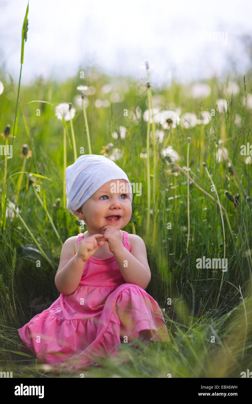baby girl outdoors at sunny summer day Stock Photo