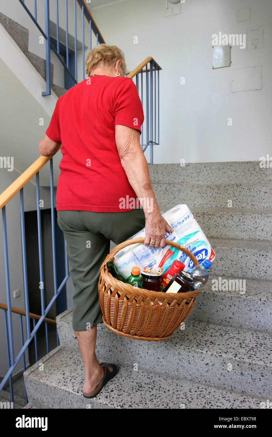 Senior Citizen With A Heavy Shopping Basket   Stock Image
