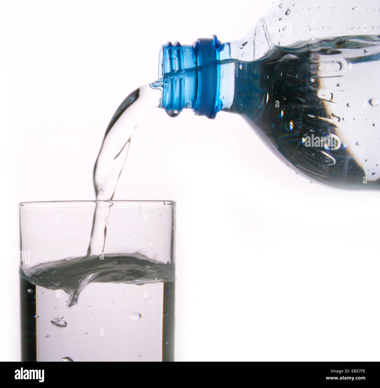 mineral water bottle with glass - Stock Image