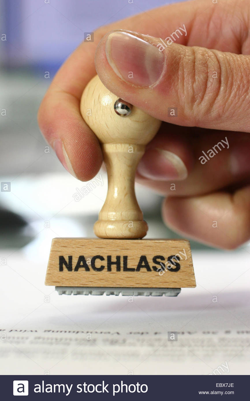 hand with a stamp Nachlass, deduction - Stock Image