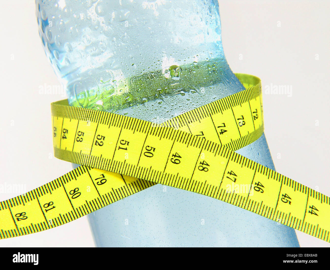 Mineral water bottle with tape measure - Stock Image
