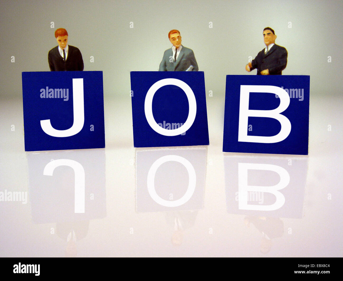head hunting, figures and writing 'Job' - Stock Image