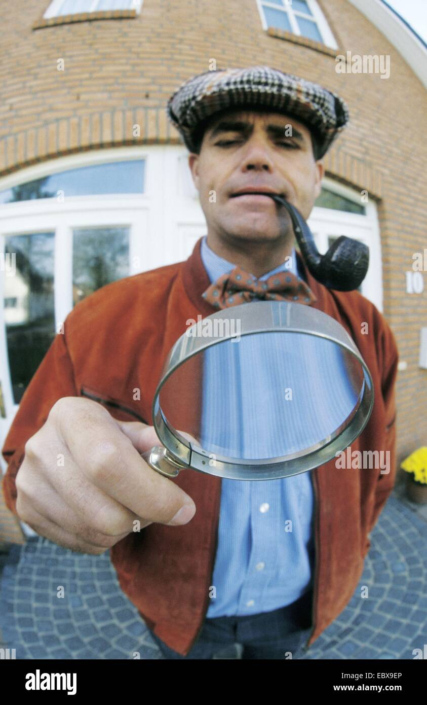 detective with loupe - Stock Image