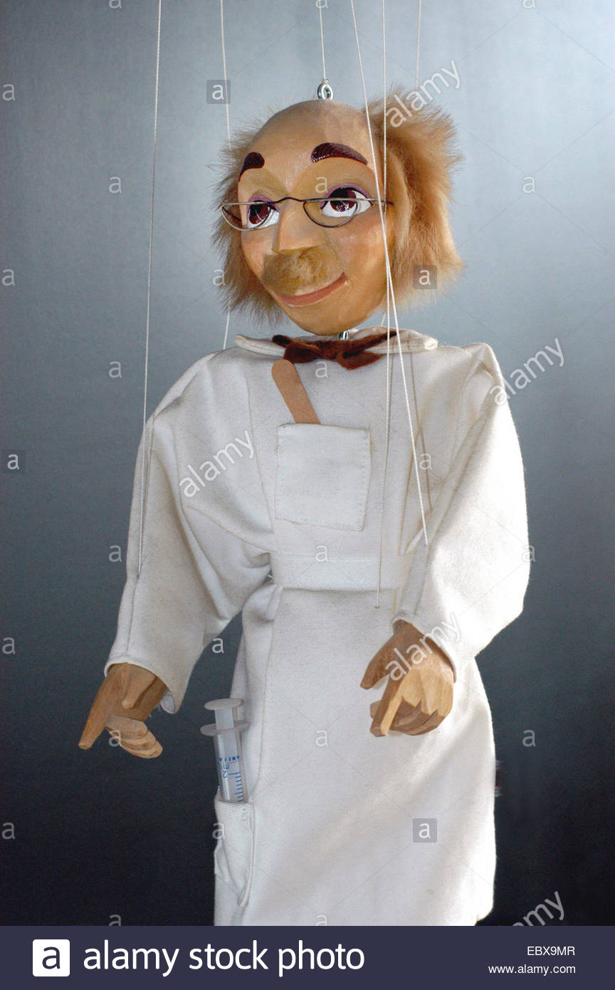 Symbol physicians as puppets - Stock Image