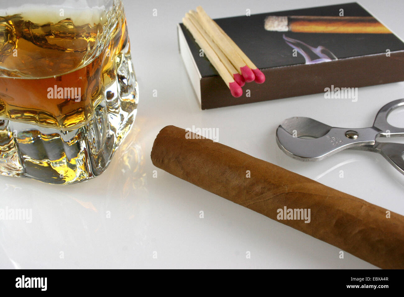 semiluxury food, cognac, cigarre and cigar cutter - Stock Image