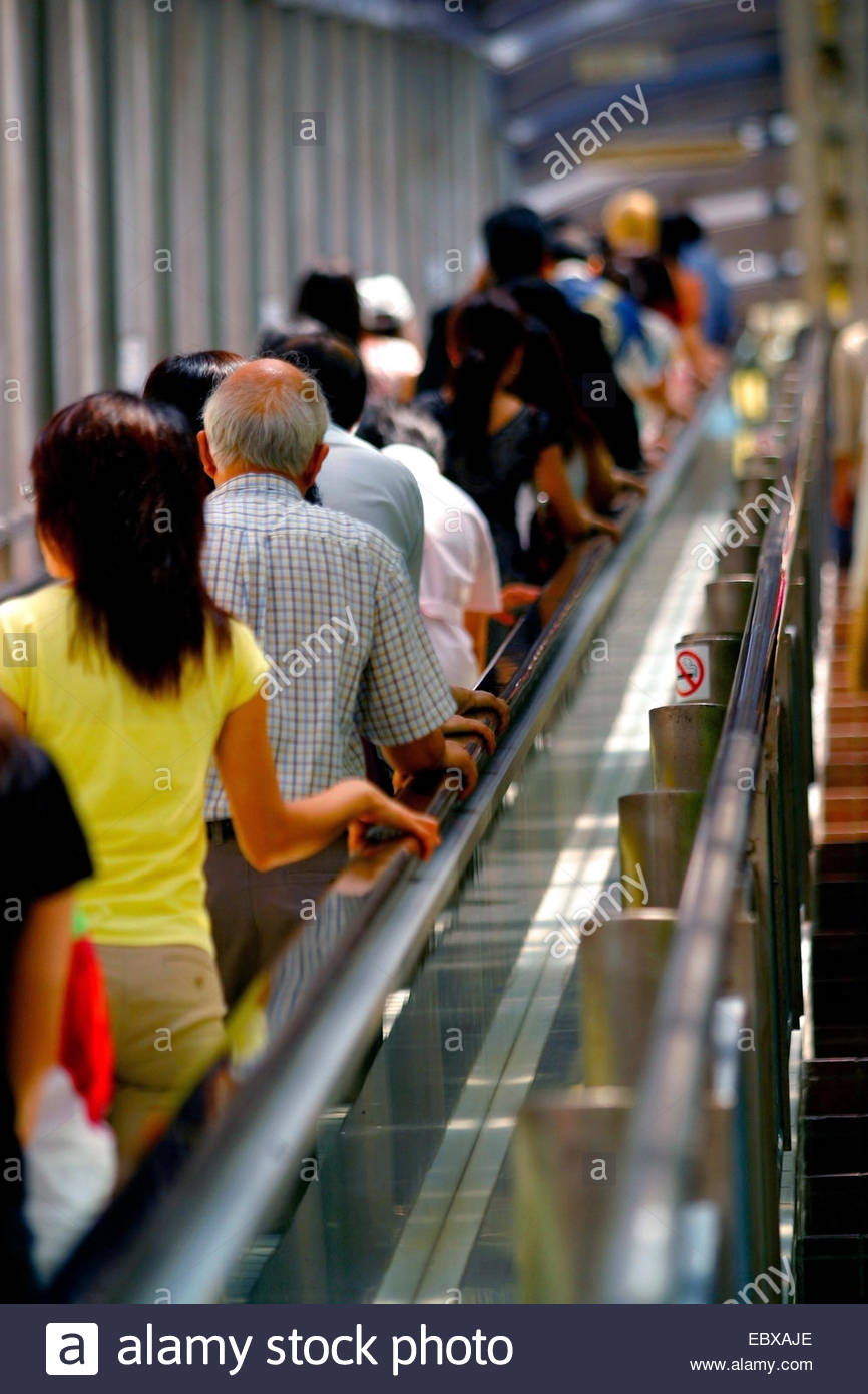 crowd of people on escalator in Hong Kong, China, Honk Kong - Stock Image