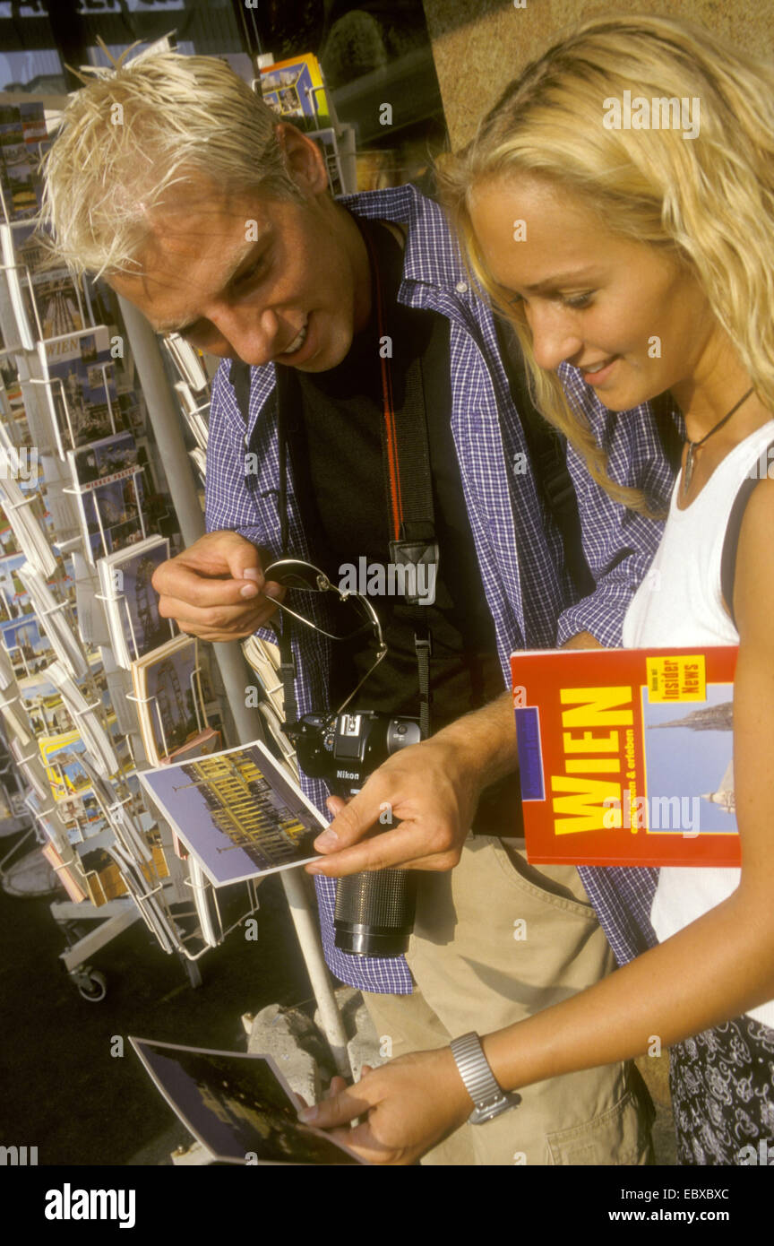young couple looks at postcards of Vienna, Austria, Vienna - Stock Image