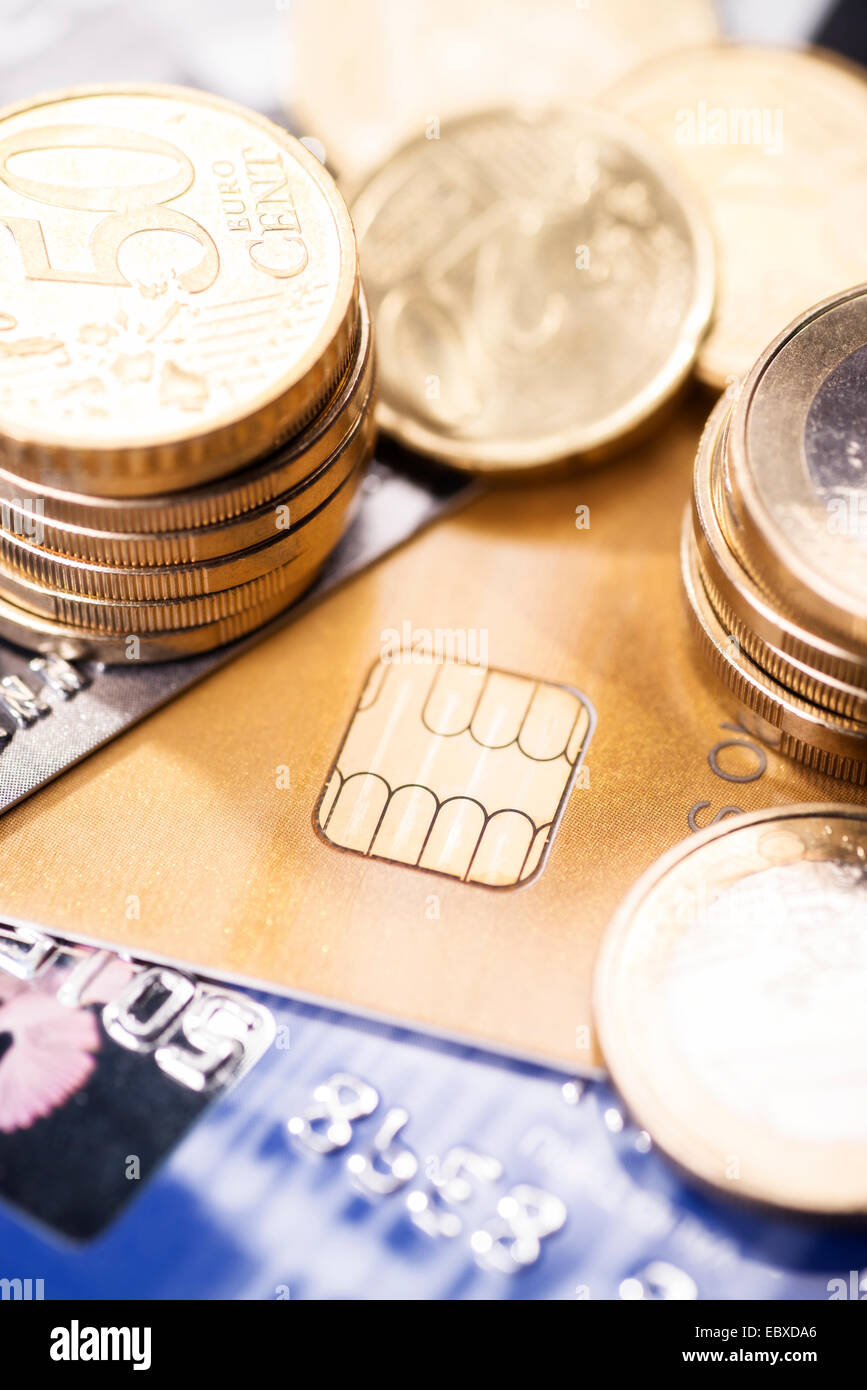 Chip on a smart card with several coins - Stock Image