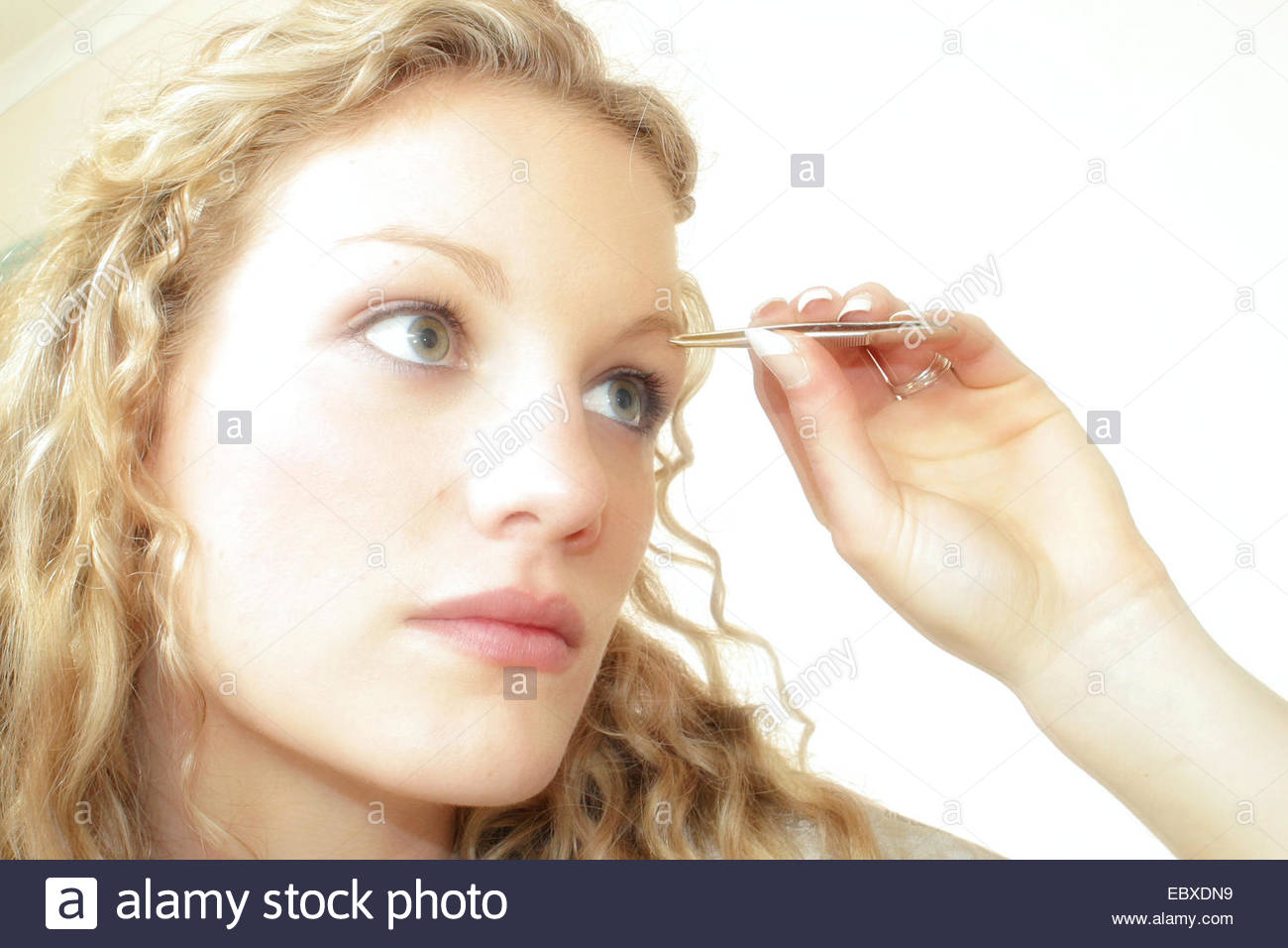 Woman Is Picking Her Eyebrows Stock Photo 76184229 Alamy