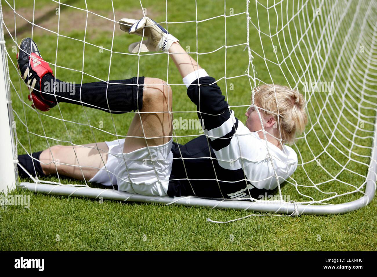 football player, goalkeeper keeping goal - Stock Image