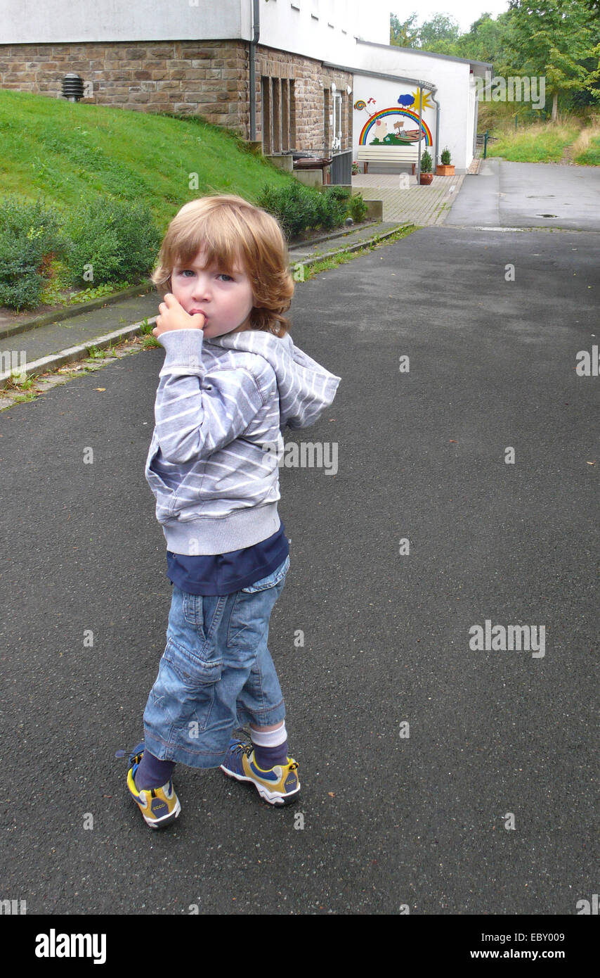 little boy is afraid of his first day in kindergarden, Germany - Stock Image
