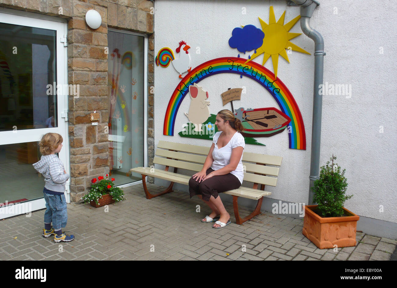 mother and sun arguing at the first day in kindergarden - Stock Image
